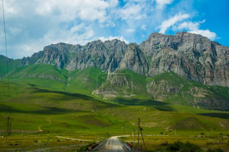 Beautiful mountains against the bright blue sky white clouds,the summer.The Caucasus. .Russia.