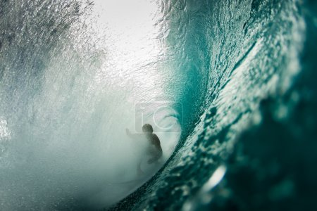Surfer surfing in ocean wave