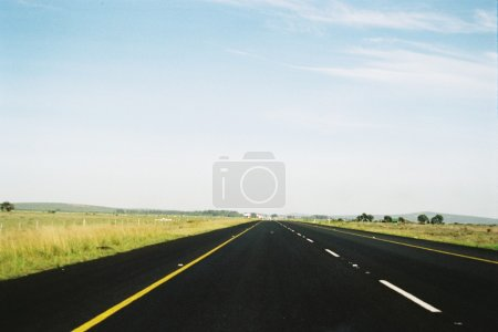 Photo for Black empty asphalt road in countryside - Royalty Free Image