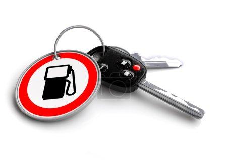 Car keys with a petrol gas pump icon on the keyring