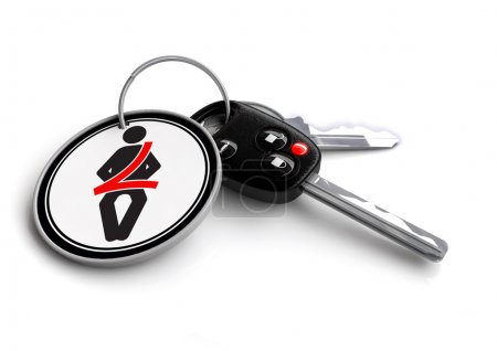Car keys with safe driving icons as keyrings
