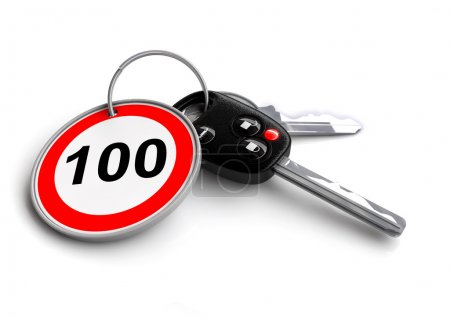 Car keys with speed limit road sign as keyring