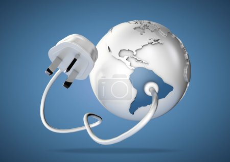 Electrical cable and plug connects power to South America on a world globe. Concept for how Brazil and Argentina consume electricity and energy and how they need to use renewable, green, alternative energy solutions like solar & wind turbine energy.