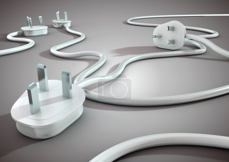 Electical cables and plugs lay on a white smooth surface and overlap each other. Concept for electricity and power usage by consumers.