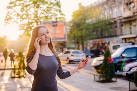 woman in city speaking on mobile phone