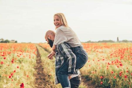 Couple having fun in field