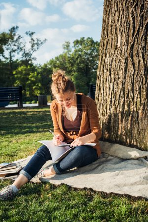 young caucasian female student with books on campus, student study in campus area