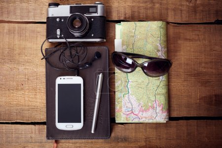 travel equipment on wooden table background