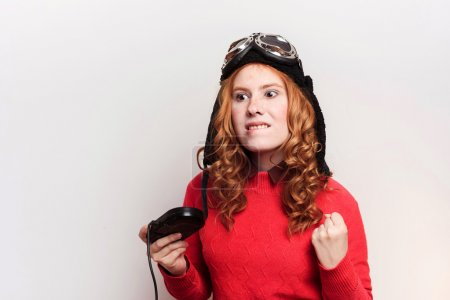 redhead woman playing video games
