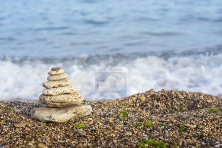 Balanced stones on a beach