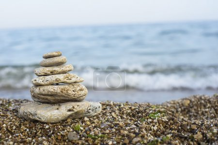 Balanced stones on a beach