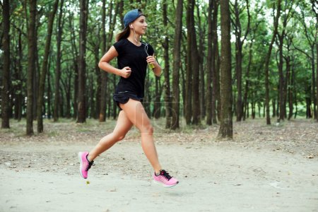 young caucasian female running in park. Female jogging in park