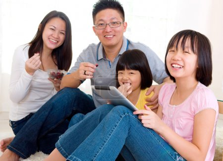 Asian family relax at home
