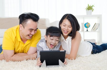 Photo for Asian family having fun with tablet computer - Royalty Free Image