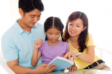 Photo for Asian family reading at home - Royalty Free Image