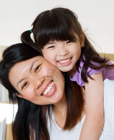Photo for Asian child hug her mother - Royalty Free Image