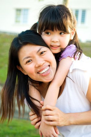 Photo for Asian mother piggyback her daughter - Royalty Free Image