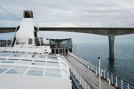 Large cruise ship passing under The Confederation Bridge, Northumberland Strait, Prince Edward Island, Canada