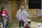 Wedding ceremony preparaton. View of the bride`s father wearing handwoven poncho and chullo - knitted hat with earflaps