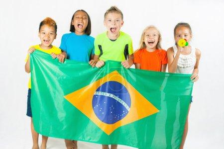 Group of children holding a Brazil flag
