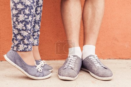 Closeup foot of kissing couple outdoor at street