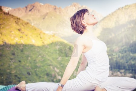 Inspired asian woman doing exercise of yoga at mountain range