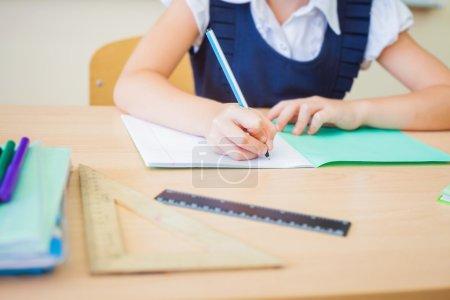 Desktop background of student sitting at desk for classwork