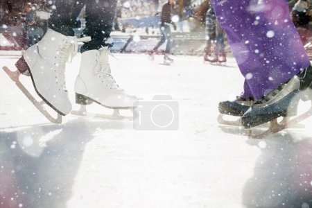Photo for Closeup skating shoes ice skating outdoor at ice rink. Magical glitter of snowy snowflakes and bokeh. Healthy lifestyle and winter sport concept at sports stadium. - Royalty Free Image