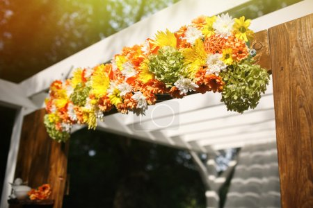stylish decorated rustic arch with flowers