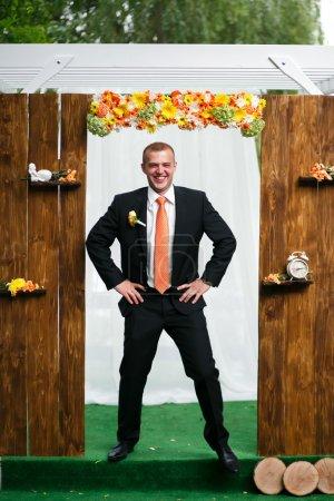 happy groom waiting bride