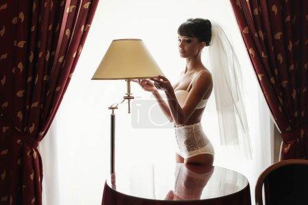 attractive bride is posing