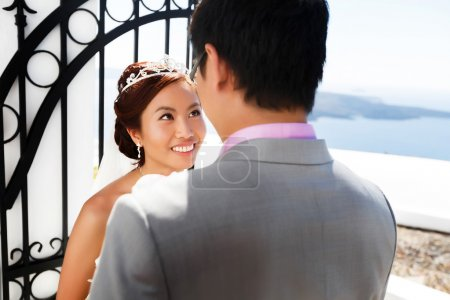 happy stylish asian bride and groom