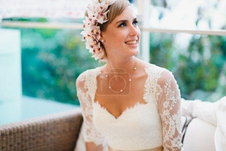 Photo for Beautiful gorgeous blonde bride  celebrating wedding on the restaurant terrace - Royalty Free Image
