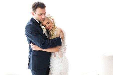 brunette groom and blonde bride