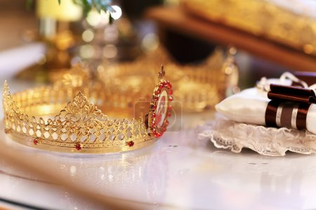 gold crown on white table