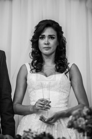 bride tearing up during a toast