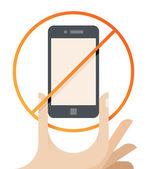 Hand holding phone with prohibited symbol