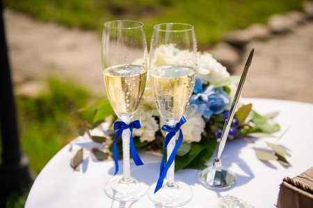 Stylish wedding glasses with champagne standing on the table