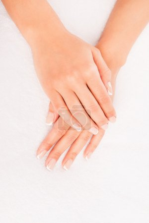 Close up photo of woman's hand with manicure on white background
