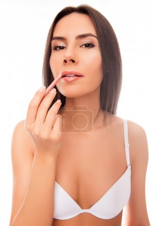 Close up portrait of woman doing maquillage with lip's liner