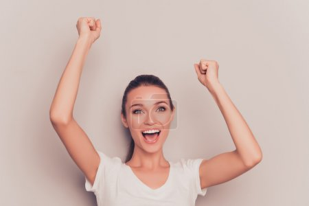 Yes! Cheerful happy woman celebrating her victory