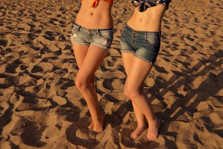 girl's sexy legs on the beach