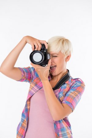 Beautiful girl smiling and photographing