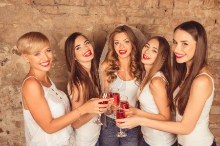 Cute young women wearing dress code celebrating hen-party with s