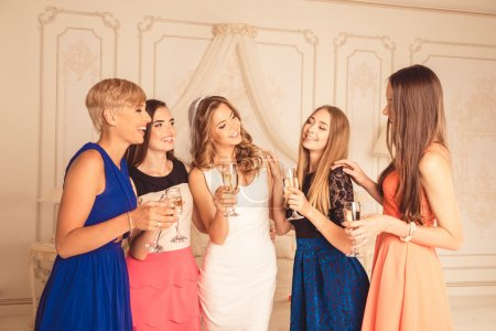 Cheerful attractive cute girls celebrate a bachelorette party of