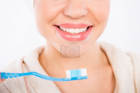 Closeup photo of young girl smiling with perfect  white teeth an