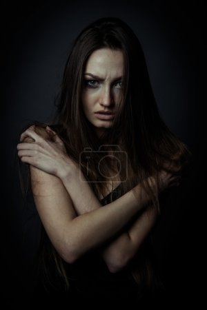 Close up portrait of a sad woman with crossed hands