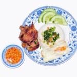 Vietnamese broken rice or Com tam on a white backg...