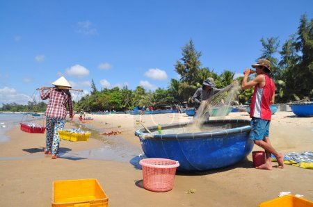 Lagi, Vietnam - February 26, 2012: Local fishermen are preparing their fishing nets for a new working day in the Lagi beach