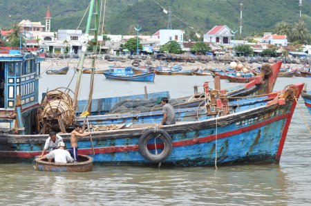 Nha Trang, Vietnam - October 5, 2011: Fishing boats are mooring in a seaport of Nha Trang